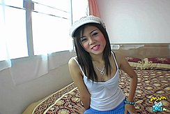 Sitting On Bed Wearing White Hat