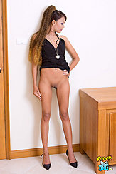 Skinny Girl Hand On Hip Dress Raised Showing Her Shaved Pussy Wearing High Heels