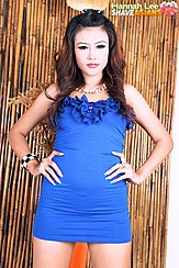 Standing With Hands On Hips Long Hair Wearing Blue Dress