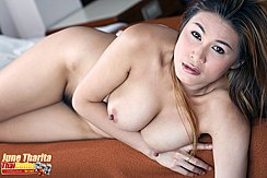 Lying On Her Side Nude On Bed Arm Folded Under Her Big Tits Hard Nipples Black Pussy Hair Squeezed Between Her Thighs
