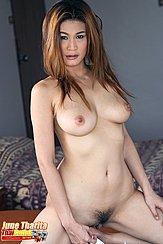 June Tharita Kneeling Nude On Bed Long Hair Flows Down To Her Breasts Legs Open Exposing Her Pussy