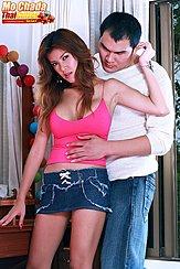 Wearing Pink Top In Denim Skirt Long Hair Boyfriend Embracing Her From Behind