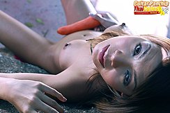 Guitar Panthip Lying Nude Against Rock Looking Up Nice Tits Legs Open Holding Carrot