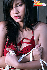 Arms Folded Under Her Chest Holding Rope