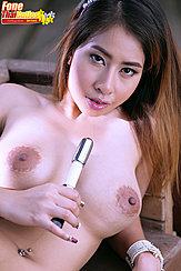 Holding Vibrator Between Her Big Tits