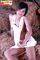Sitting on hay bales wearing dungarees short hair