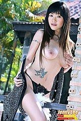 Astride Fence Topless In Panties Hand On Big Tits