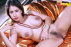 Reclining On Bean Bag Nude Necklace Circling Her Big Breasts Legs Spread Exposing Her Pussy