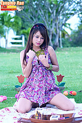 Seated On Picnic Blanket In Dress