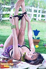 Lying On Her Back Legs Raised Bare Feet Pulling Panties Off