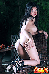 Kneeling On Chair Naked Looking Over Her Shoulder Hand On Her Ass In High Heels