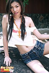 May Supha Sitting On Rock Long Hair In Pigtails Wearing Denim Shorts