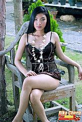 Sitting On Chair Legs Crossed