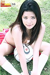 Seated Topless Football Between Her Legs