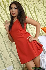 Standing Beside Bed Long Hair Over Her Red Dress Hand On Hip