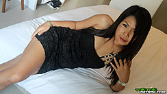 Lying On Bed Wearing Black Dress Playing With Her Long Hair