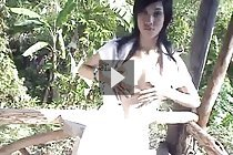 Yoko dancing and stripping white dress outdoors